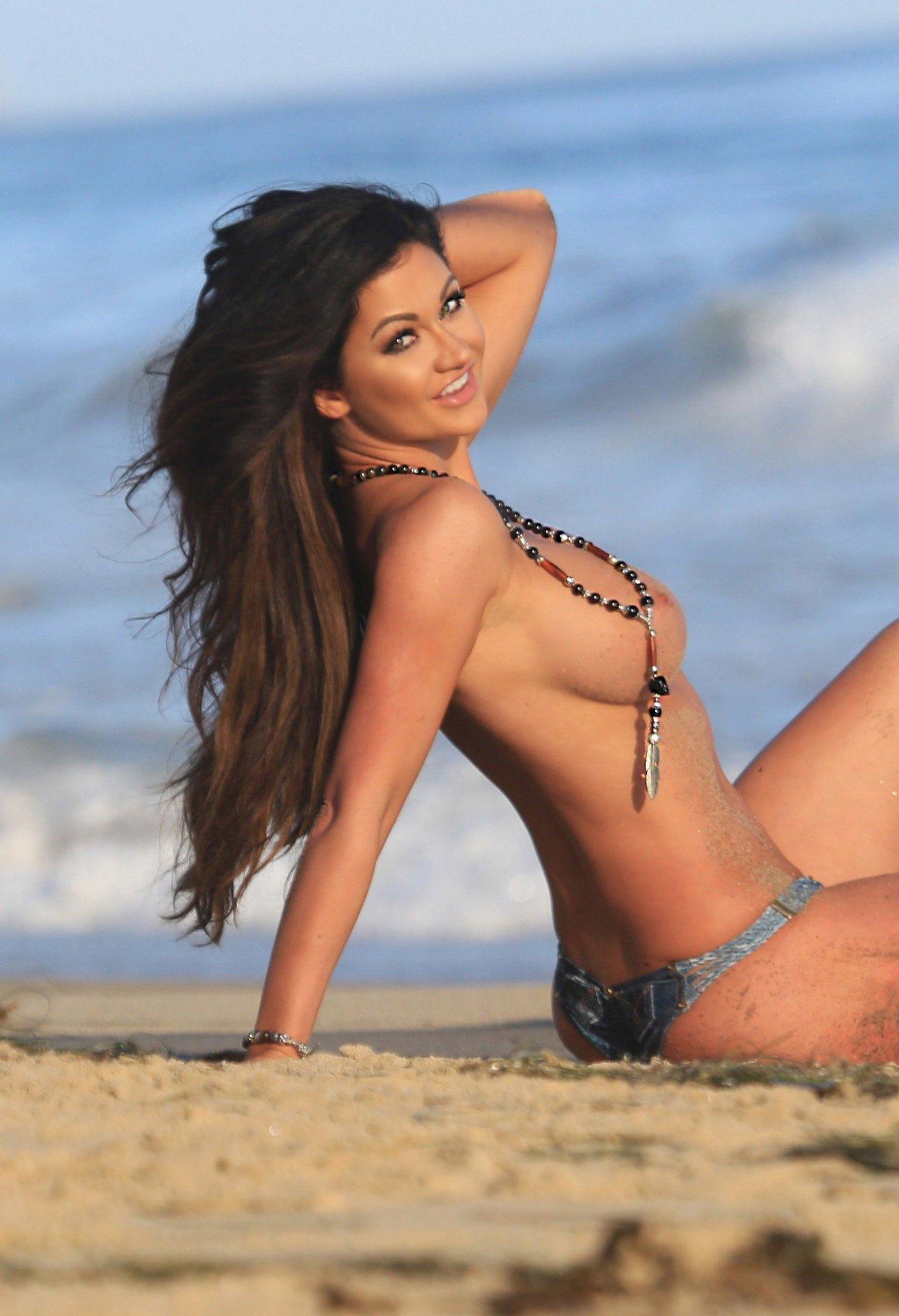 Naked photoshoot on beach